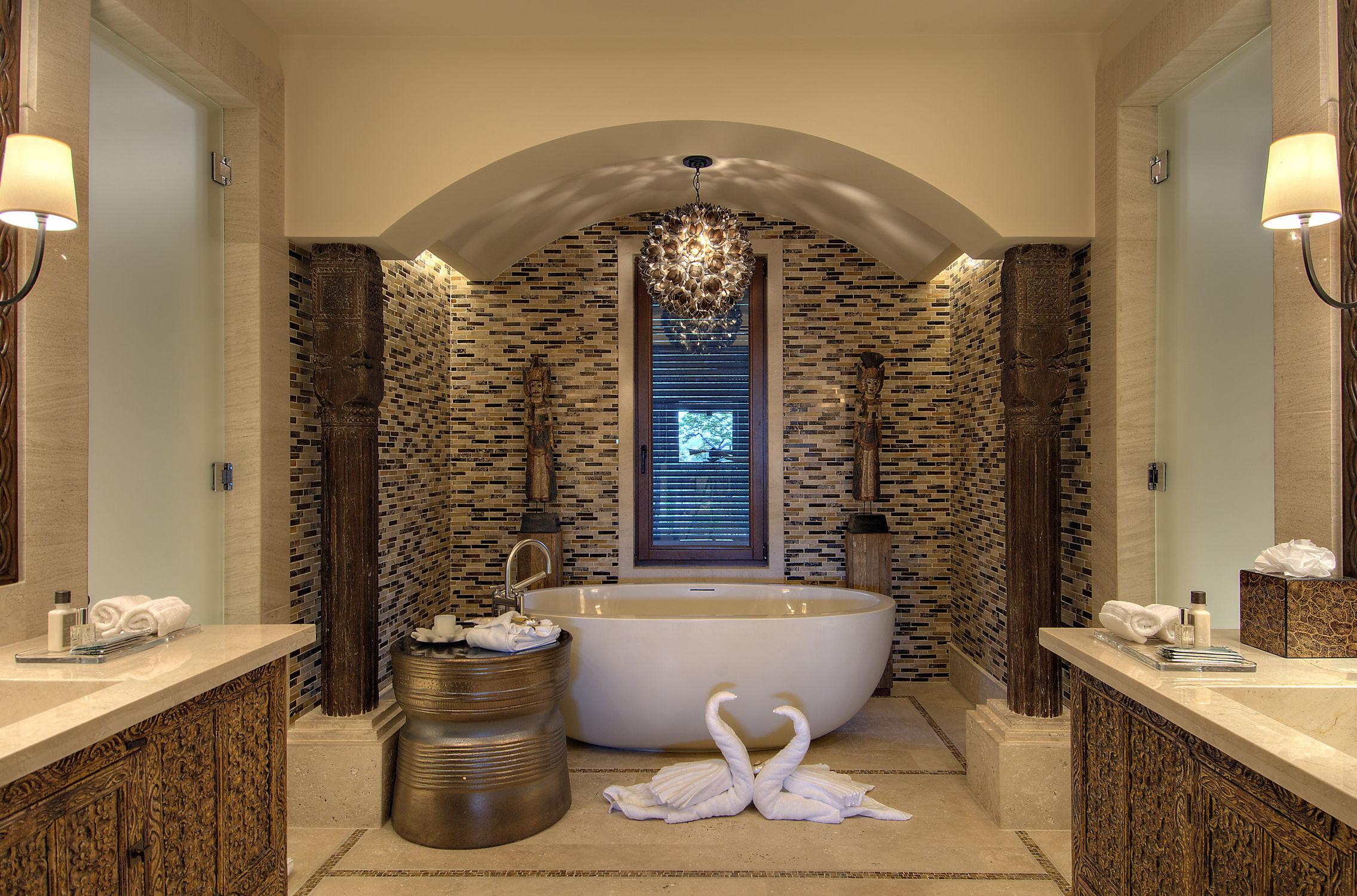 vasca da bagno ad isola ovale in composito in pietra oceanus tyrrell and