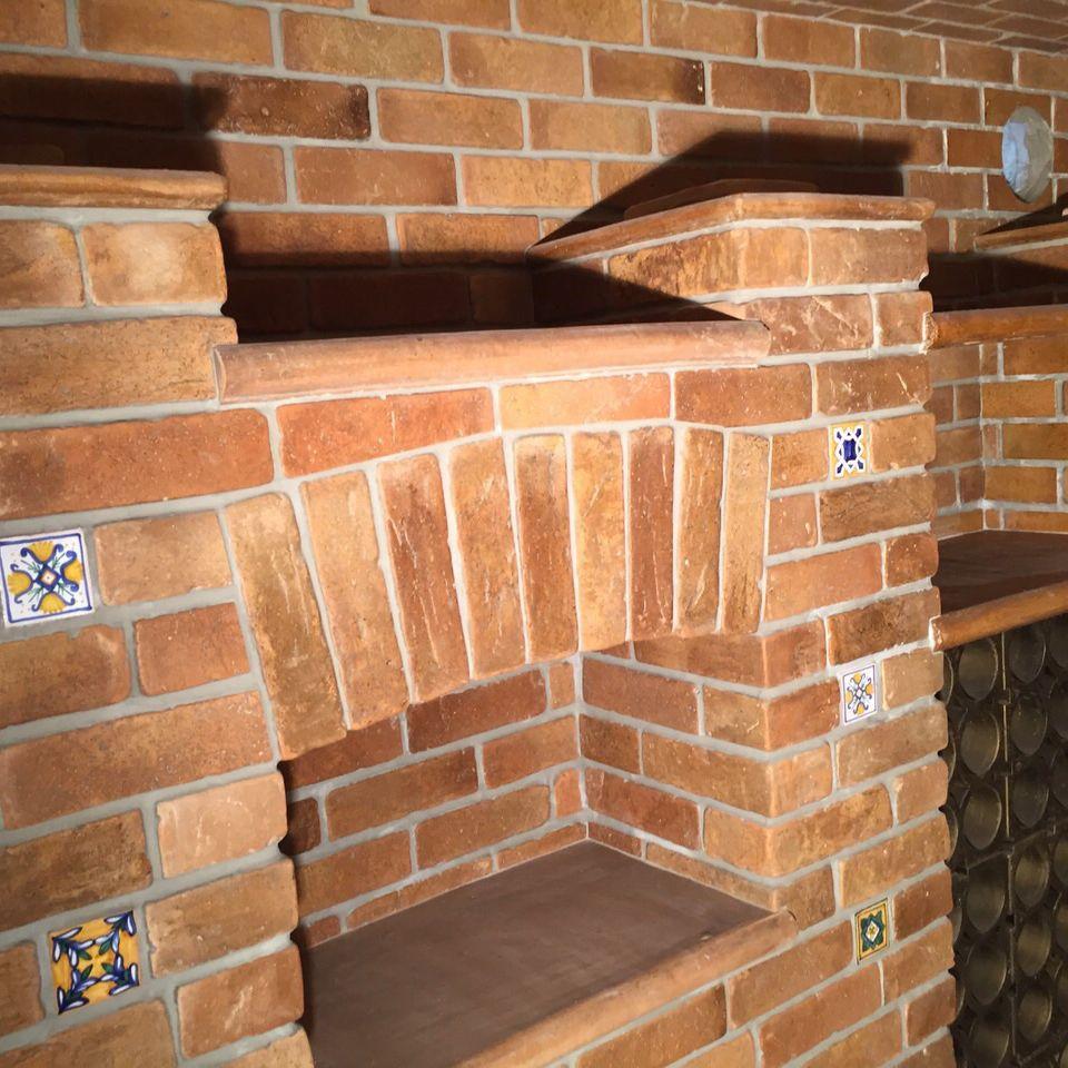 Paramento in mattoni in laterizio / per facciata / a rilievo / fatto ...