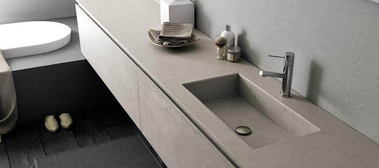 Mobile lavabo sospeso / in cemento / moderno / con armadietto ...