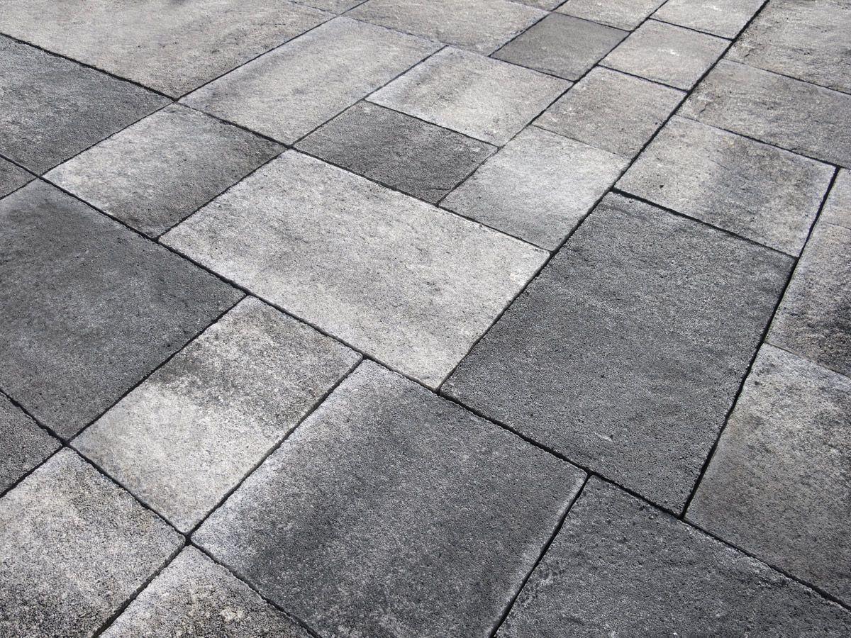 Quadro su tela vecchie piastrelle del marciapiede con le piante