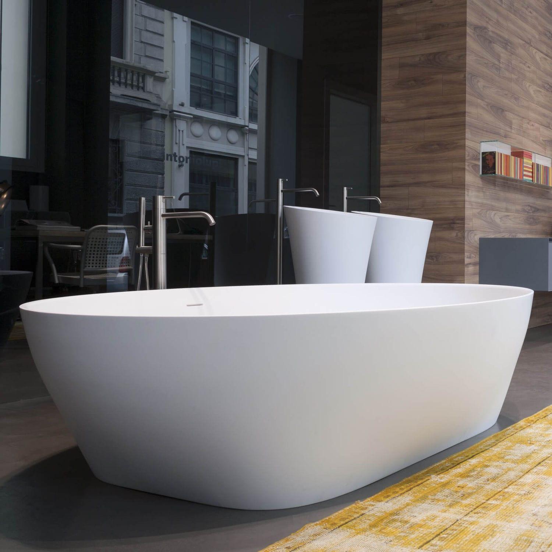 Vasca da bagno da appoggio / ovale / in marmo / in plastica ...