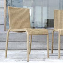 Sedia da giardino moderna / impilabile / in resina intrecciata