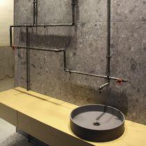 Lavabo da appoggio / rotondo / in calcestruzzo / moderno