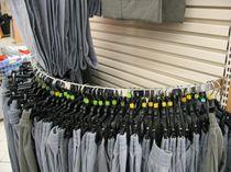 Espositore da parete / per abbigliamento / in metallo / per negozio