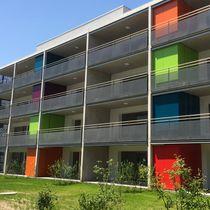 Rivestimento di facciata per facciata ventilata / in HPL / liscio / colorato