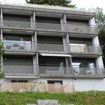 Ringhiera in fibra di legno / a pannelli / da esterno / per balcone