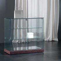 Vetrina moderna / con piede / in vetro / bassa