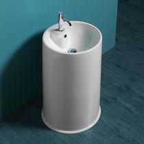 Lavabo da terra / rotondo / in ceramica / moderno