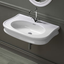 Lavabo sospeso / ovale / in ceramica / classico