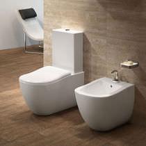 WC da appoggio / monoblocco / in ceramica