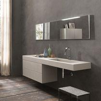 Mobile lavabo sospeso / in cemento / moderno / con specchio