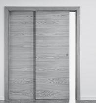 Sistema scorrevole per porte in legno