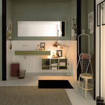 Mobile lavabo sospeso / in Solid Surface / moderno / con scaffale integrato
