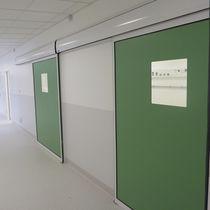 Porta industriale scorrevole / in metallo / semivetrata / interna