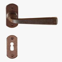 Maniglia per porta / in ferro modellato / classica / finitura oro