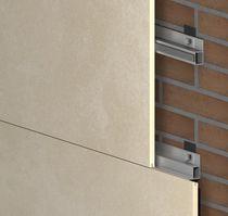 Sistema di fissaggio metallo / per rivestimento di facciata / per interni