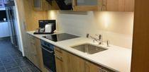 Piano di lavoro in pietra naturale / in legno / da cucina / bianco