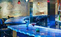 Bancone da bar / in vetro / a semicerchio / luminoso
