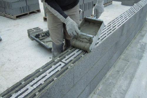 blocco di calcestruzzo forato / per muro portante / di riparazione / con posa a giunto sottile