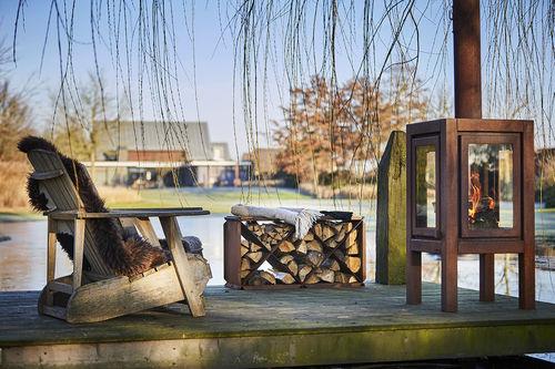 camino da giardino / a legna / tradizionale / con focolare chiuso
