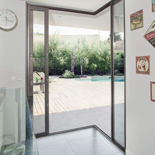 vetrata scorrevole / in alluminio / a tripli vetri / a doppi vetri