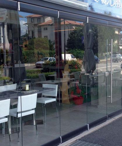 parete pieghevole / vetrata / ad uso professionale / senza montante verticale