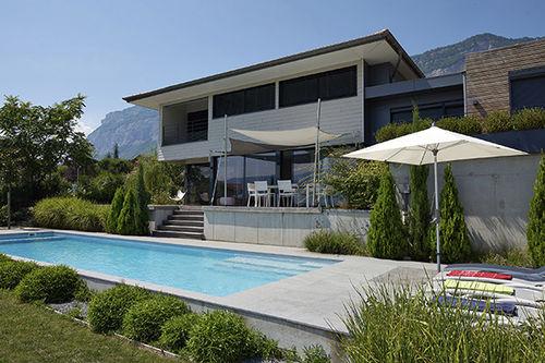 piscina seminterrata / in calcestruzzo / per hotel / da esterno
