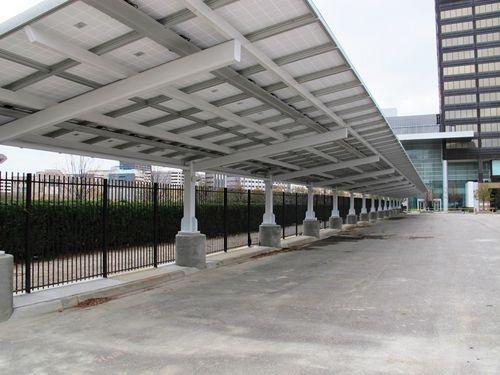 tettoia per posto-auto in acciaio / contract / con pannelli fotovoltaici integrati