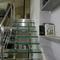 scala a L / con struttura in acciaio inossidabile / con gradini in vetro / senza alzata