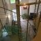 scala a chiocciola / elicoidale / con struttura in acciaio inossidabile / con gradini in vetro