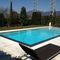 prendisole moderno / in acciaio inossidabile / per piscina