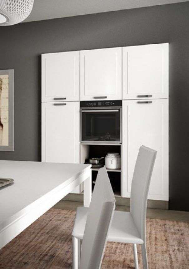 Cucina moderna / in legno / a L / con impugnature ...