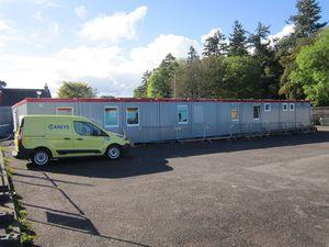 costruzione di container per edifici aperti al pubblico