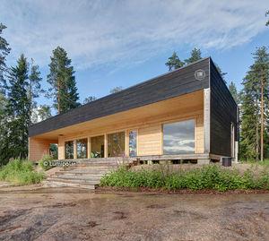 casa tipo / moderna / in legno lamellare / ecologica