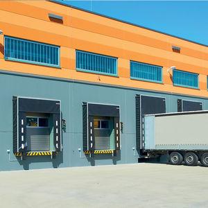 porte industriali sezionali / in acciaio / automatiche / a isolamento termico