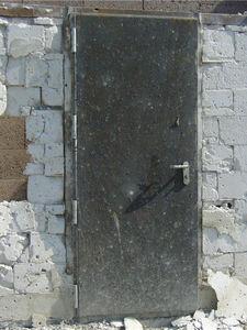 porte industriali battenti / in acciaio galvanizzato / antiurto