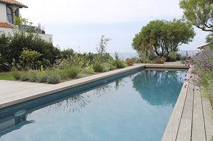 piscina interrata / in calcestruzzo / per hotel / in mosaico