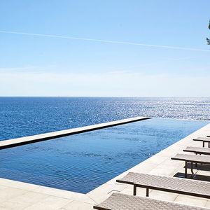 piscina interrata / in calcestruzzo / in gres porcellanato / per hotel