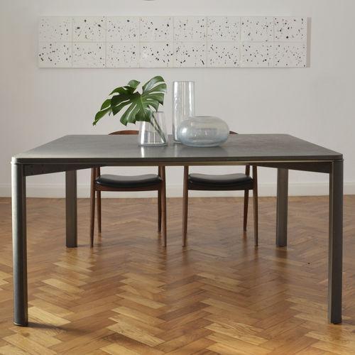 tavolo da pranzo moderno / in ottone / in basalto / rettangolare