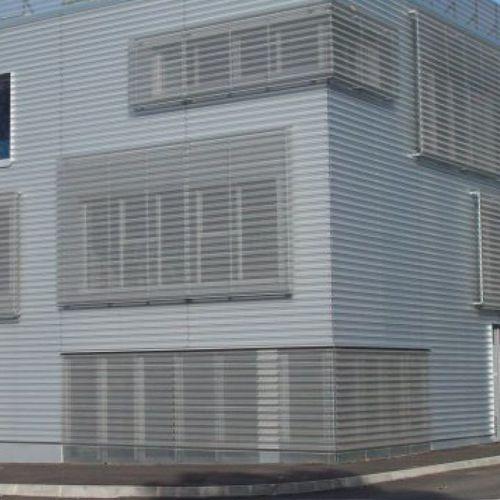 rivestimento di facciata in pannelli / in acciaio / in acciaio galvanizzato / in zinco-alluminio