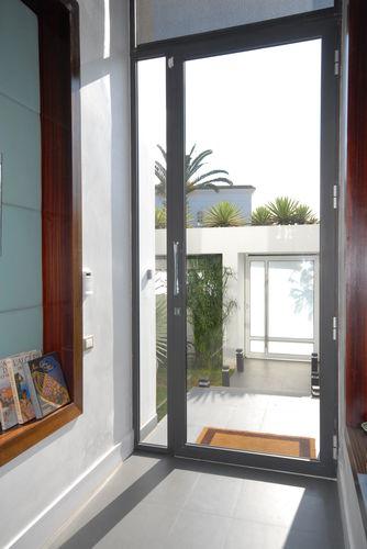 porta d'ingresso / battente / in alluminio / vetrata