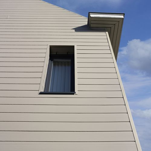 rivestimento di facciata a doghe / in PVC / con scanalature / aspetto legno