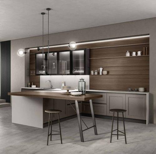 cucina moderna / in legno massiccio / in pietra / a scomparsa