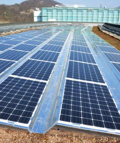 sistema di montaggio per tetto di tegole / per tetti piani / aerodinamico / per applicazioni fotovoltaiche