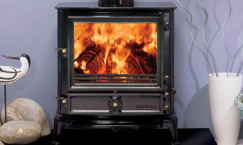stufa a legna / multicombustibile / in acciaio inox / tradizionale