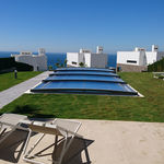copertura per piscina bassa / telescopica / in alluminio / ad azionamento manuale