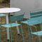 sedia moderna / con braccioli / impilabile / in acciaio galvanizzato