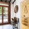 specchio a muro / moderno / tondo / per uso contract