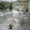 tavolo moderno / in acciaio / tondo / da giardino