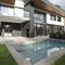 piscina interrata / in gres porcellanato / contract / a straripamento